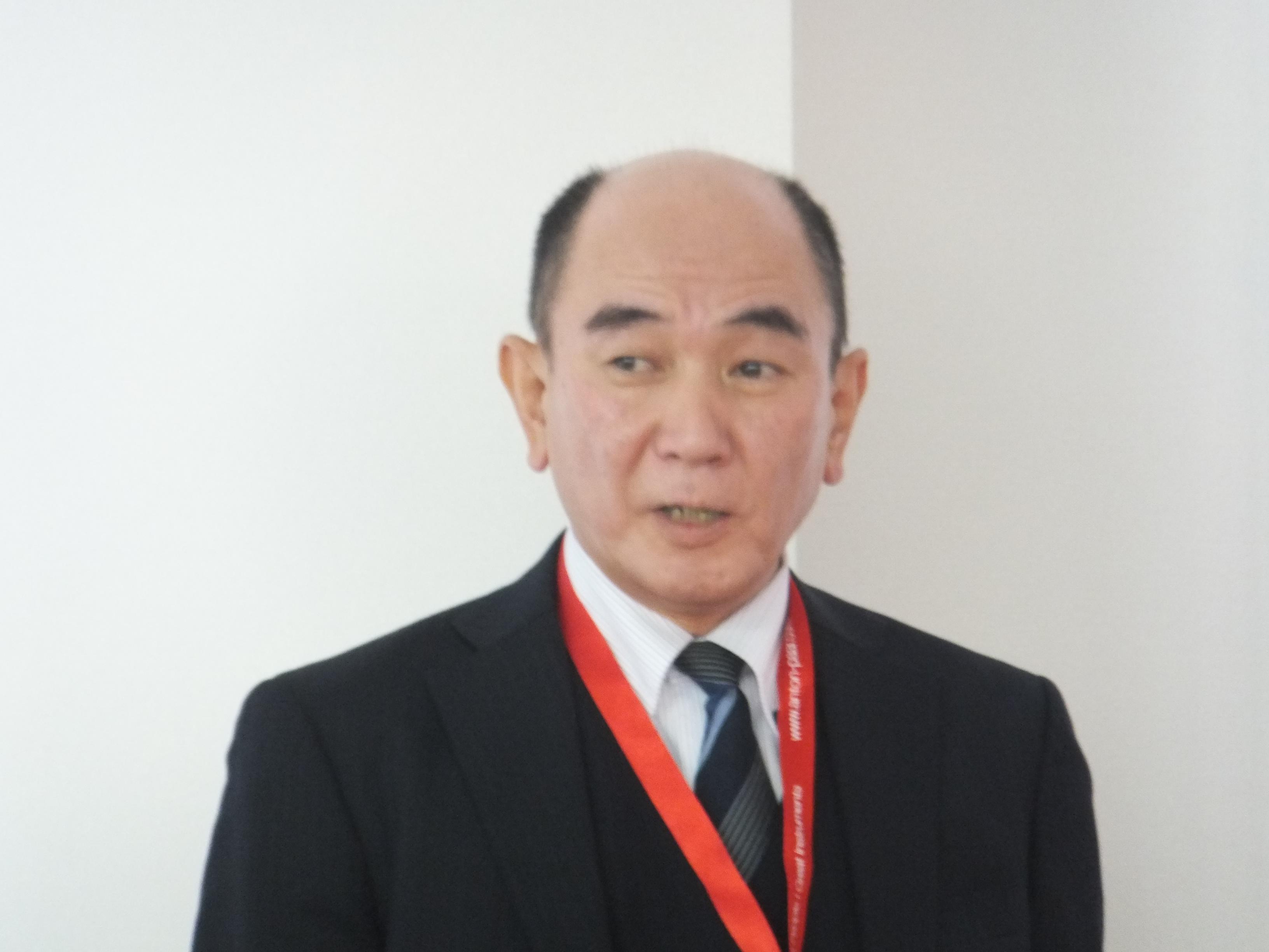 説明する飯田社長