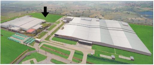 ヨコハマタイヤ・マニュファクチャリング・タイの外観図(写真左上矢印の部分が第2工場建設予定地)