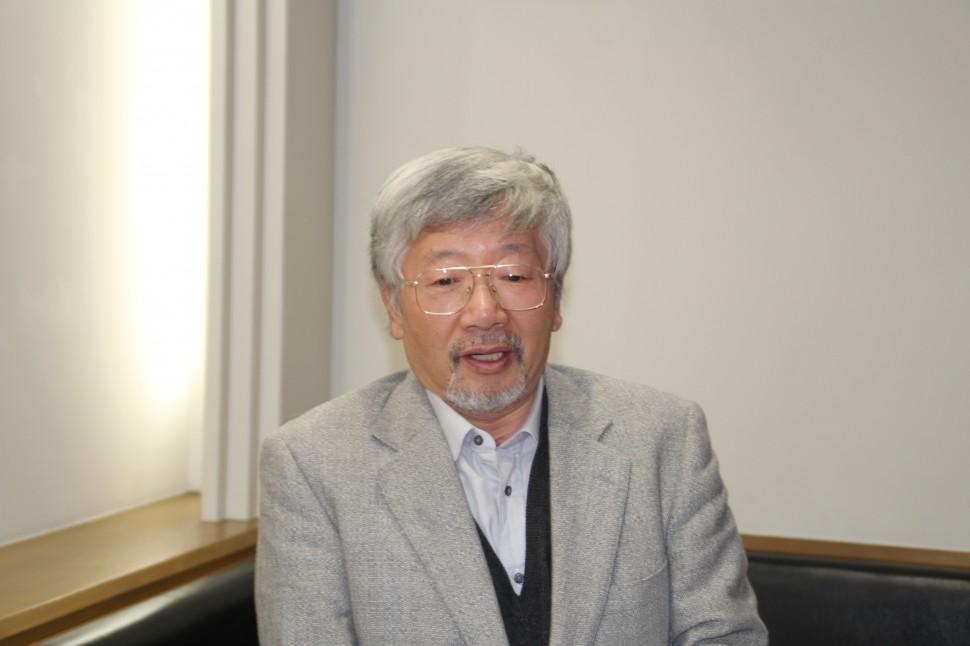 あいさつする藤井会長