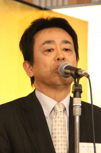 付加価値が高い仕事で貢献していくと述べる川島理事長