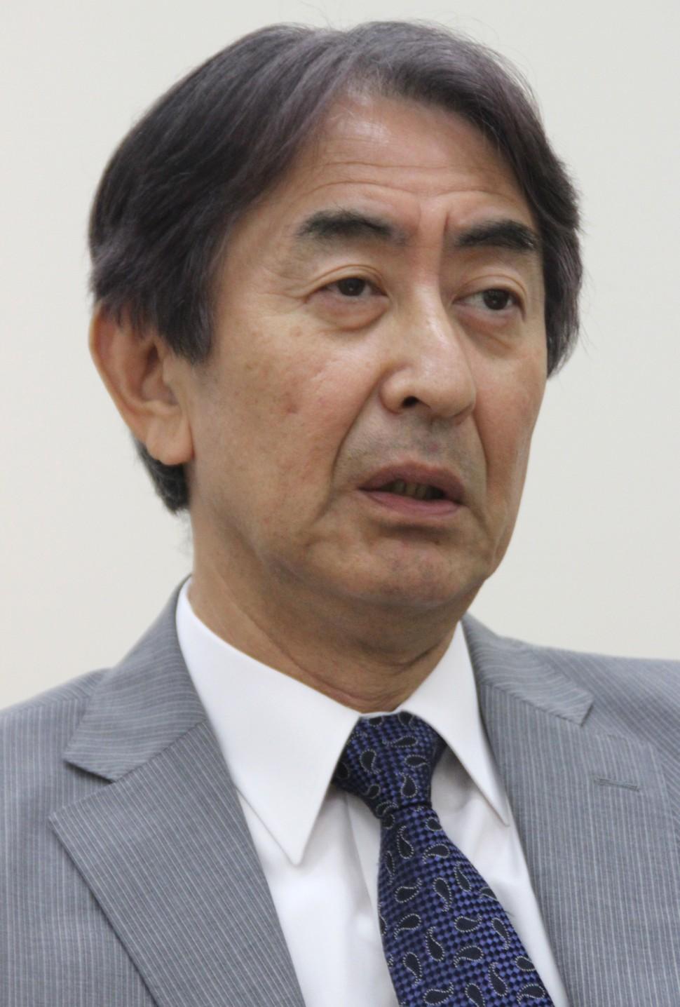 質問に答える田中社長