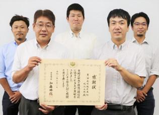稲沢工場の工場長と事務局メンバー